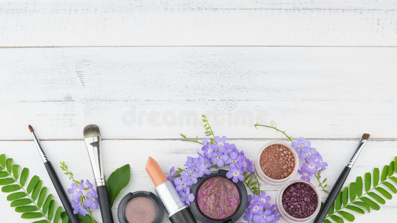 Purple flowers, green leaves, cosmetics stock image
