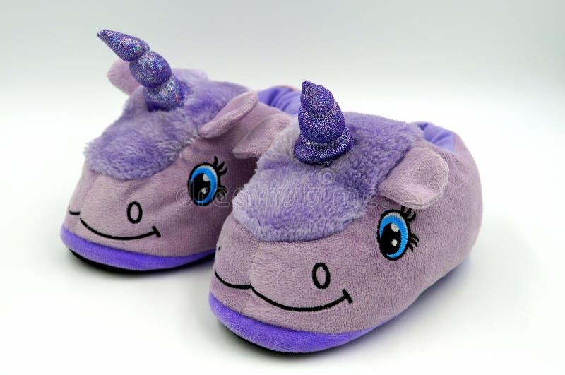 Purple fluffy unicorn winter slippers royalty free stock photo