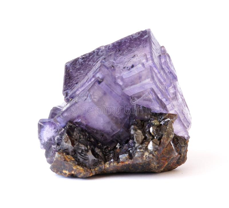 Purple Fluorite crystals on Sphalerite. Purple Fluorite crystal cluster on a matrix of black Sphalerite. This piece is from the Elmwood mine, Tennessee, USA royalty free stock image