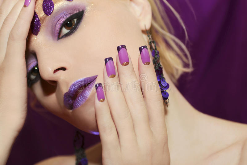 Purple French manicure and makeup. royalty free stock photos