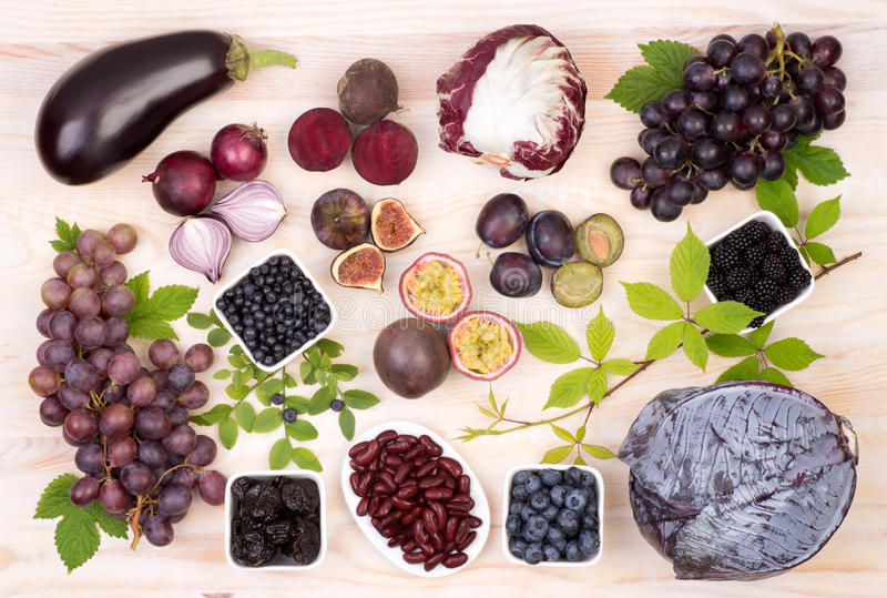 Purple fruit and vegetables stock image