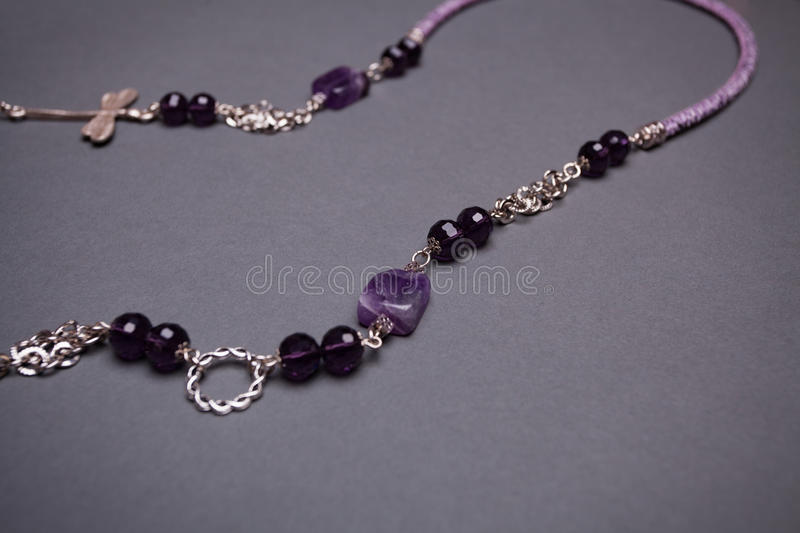 Purple Gemstone and Glass Bead Chain Necklace Detain - Copy Space.  stock photo