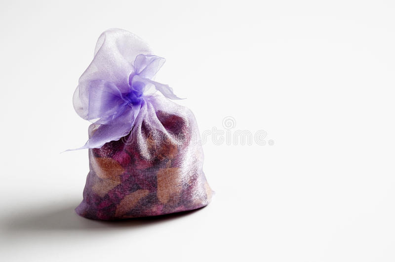 Purple gift. Wrapped in a white background. (gift packages of dry petals stock photo