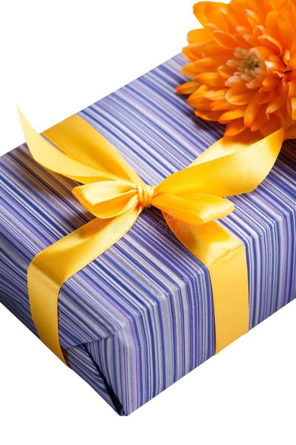 Purple gift box with yellow ribbon stock photography