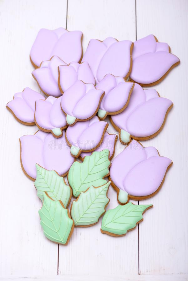Purple gingerbread cookies in the shape tulips flowers royalty free stock photo