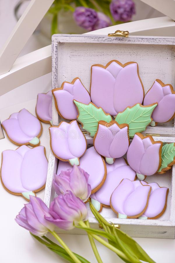 Purple gingerbread cookies in the shape of tulips with natural f royalty free stock photos