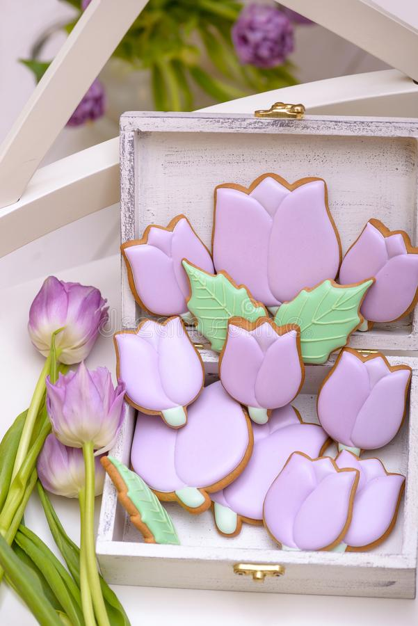 Purple gingerbread tulips cookie in wooden box with natural flow royalty free stock photography