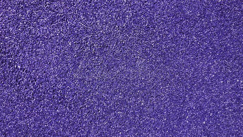 Purple glitter background sparkling shiny. Wrapping paper texture for Halloween holiday seasonal wallpaper decoration, winter greeting and card design element stock images