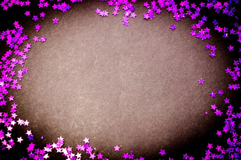 Purple glitter stars white background with copy space stock images