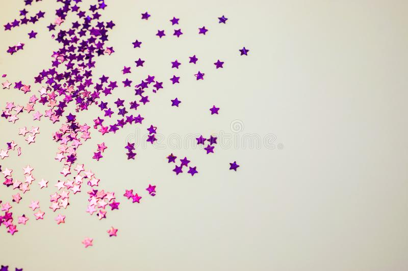 Purple glitter stars white background with copy space royalty free stock images