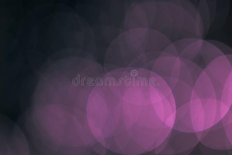 Purple glitter vintage lights background,bokeh background,defocused. royalty free stock images