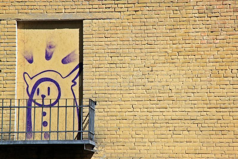 Purple graffiti on the wall royalty free stock photography