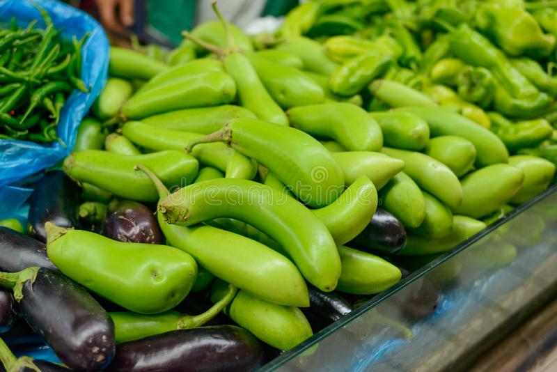 Purple and green eggplants. Fresh vegetables at a market stall. Healthy vegetarian food royalty free stock images