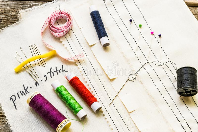 Topview of sewing supplies and stitches on muslin cloth royalty free stock photo