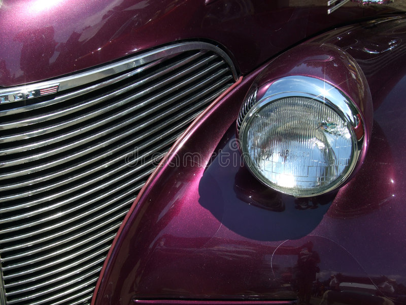 Purple Grill. A purple vintage car grill and headlight stock images