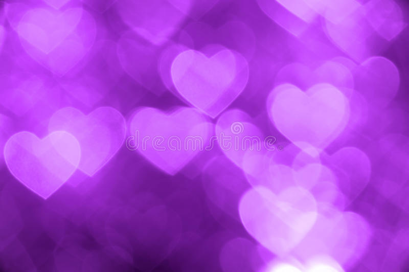 Purple heart bokeh background photo, abstract holiday backdrop royalty free stock image