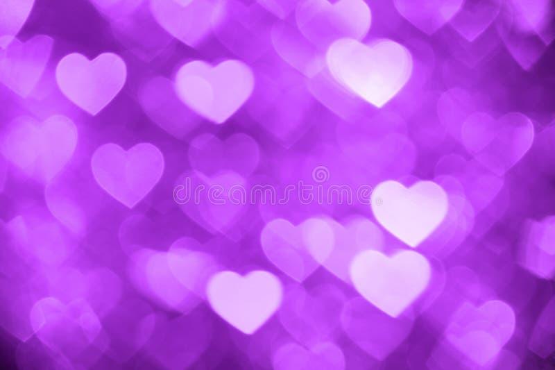 Purple heart bokeh background photo, abstract holiday backdrop royalty free stock photos