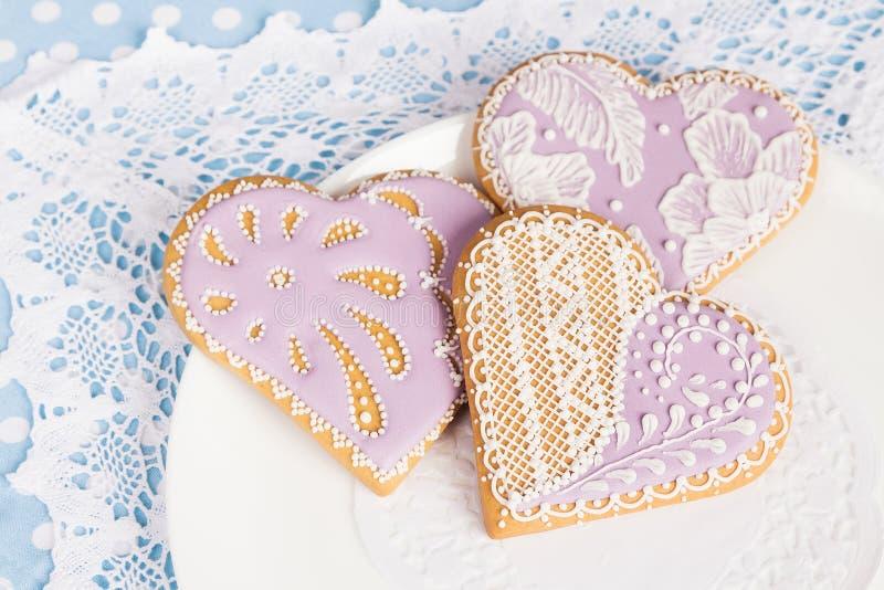 Purple heart shape gingerbread cookies stock image