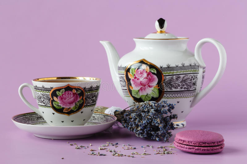 Purple heather with antique porcelain tea cup with saucer and te. A, lavender tea, sunny day, daylight stock photo
