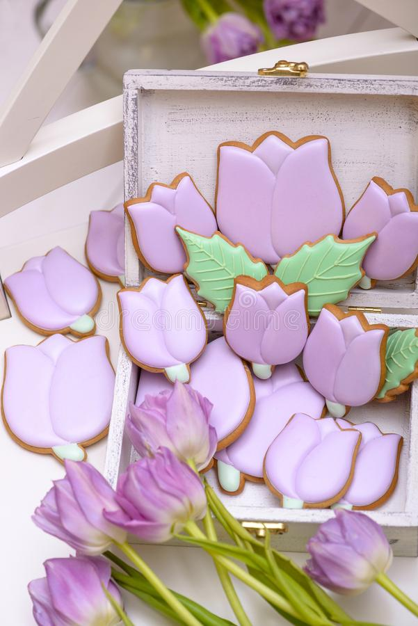 Purple homemade gingerbread cookies in the shape of tulips royalty free stock image