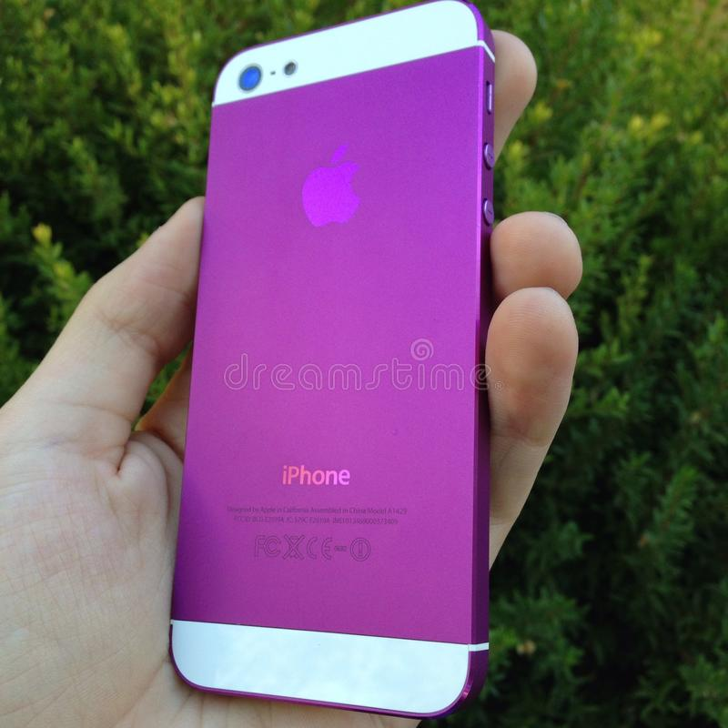 Purple iphone royalty free stock photography