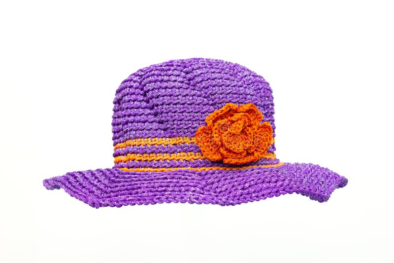 Purple knit cloth hat and Striped flower orange color . royalty free stock image