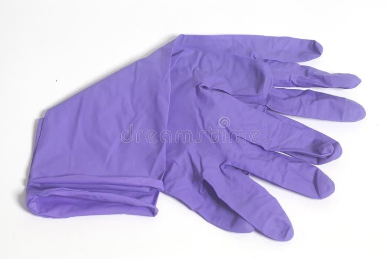 Purple latex gloves royalty free stock photos