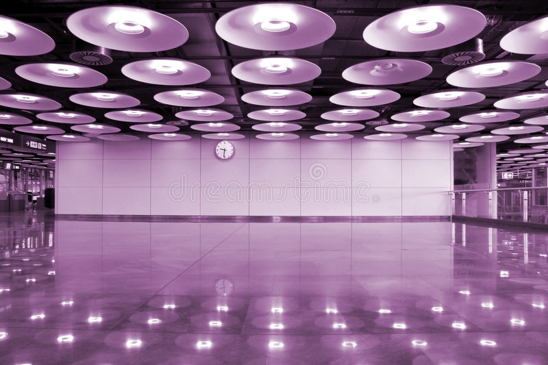 Purple lights. Airport interior and lights in the airport of Madrid in Spain royalty free stock photos