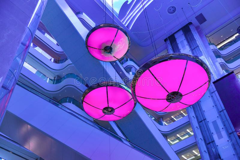 Purple lights shine in commercial building mall royalty free stock photos