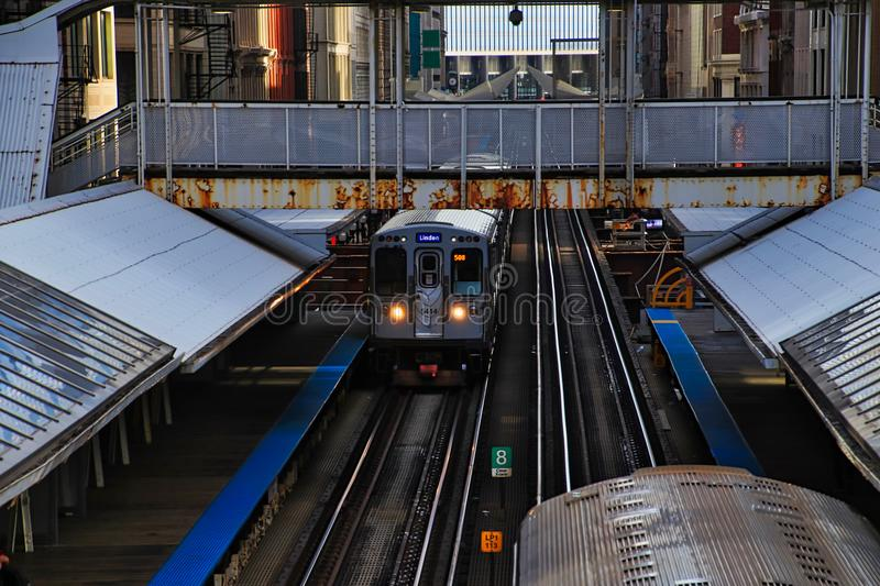 Purple line Chicago el train entering station at Adams and Wabash in the downtown Loop. Purple line Chicago el train entering station located at Adams Street royalty free stock photo
