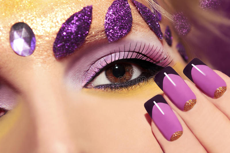 Purple makeup and nails. stock image. Image of face, leaves - 40857409