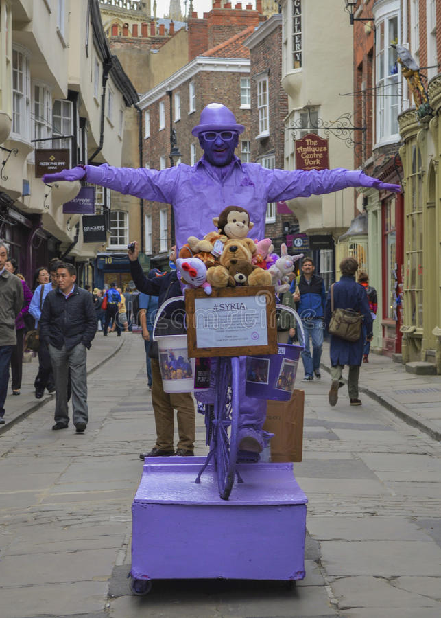 Purple Man Street Performer, Statue, York, England stock photography