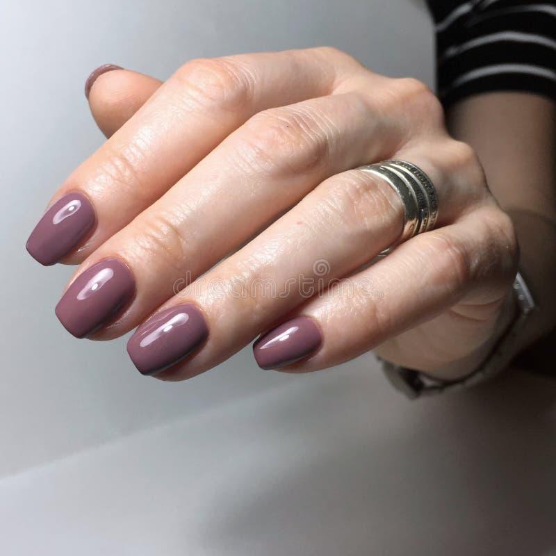 Purple manicure on the nails. Purple nail design on the fingers. Purple manicure on the nails. Purple nails design on the fingers. Manicure gel nail polish royalty free stock photo