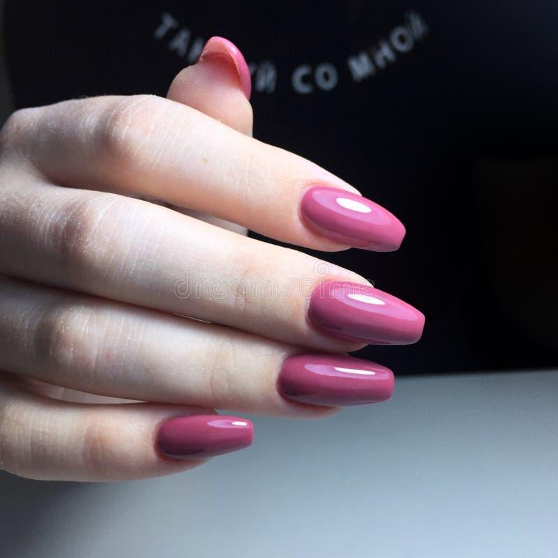 Purple manicure on the nails. Purple nail design on the fingers. Purple manicure on the nails. Purple nails design on the fingers. Manicure gel nail polish stock photography