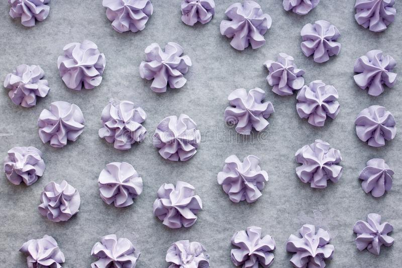 Purple meringues, sweet meringue crisp cookies made from egg whites and sugar. For topping desserts or kid treats stock photos