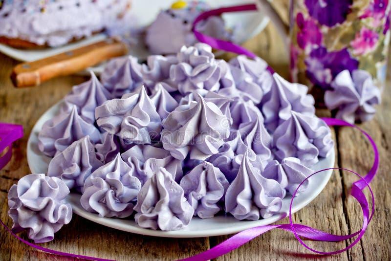 Purple meringues, sweet meringue crisp cookies royalty free stock photos