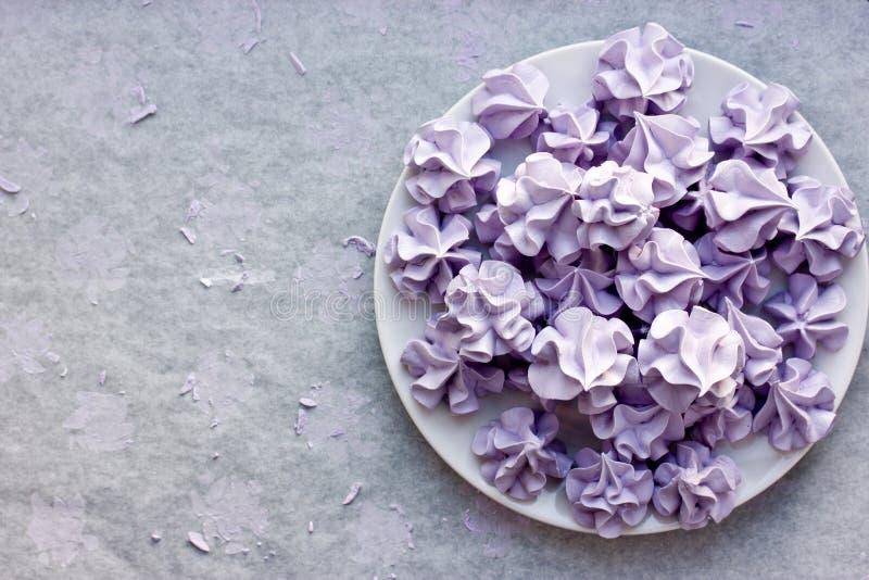 Purple meringues, sweet meringue crisp cookies stock photos