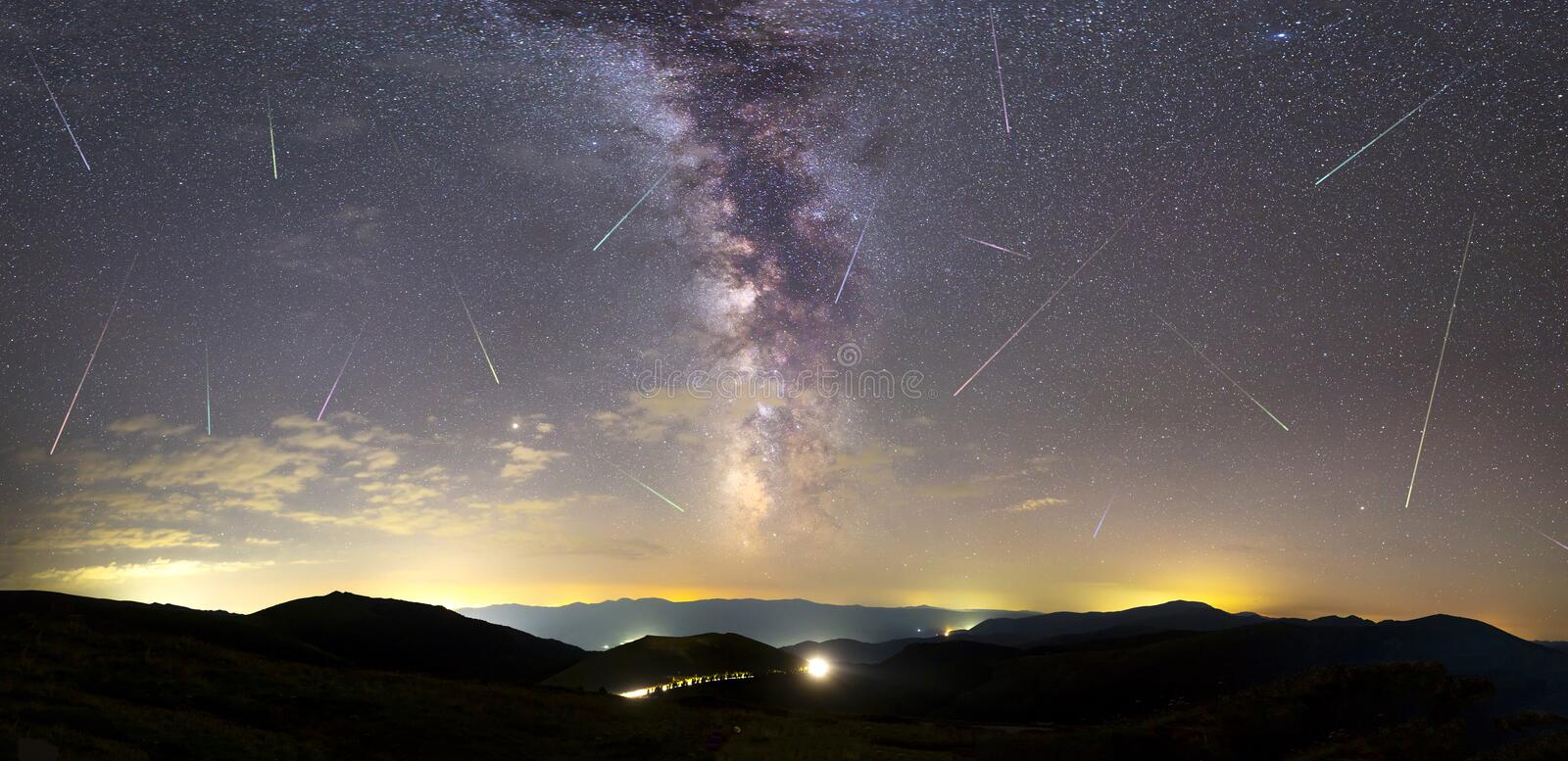 Purple Milky way falling stars city panorama royalty free stock photography