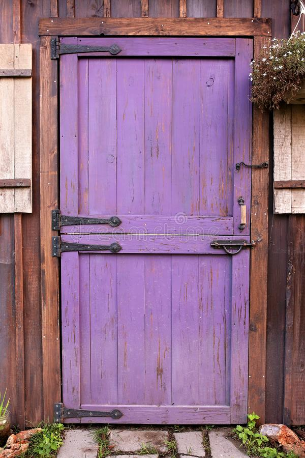 Free Purple Old Dutch Barn Style Garden Shed Door With Hardware Stock Photo - 129581200