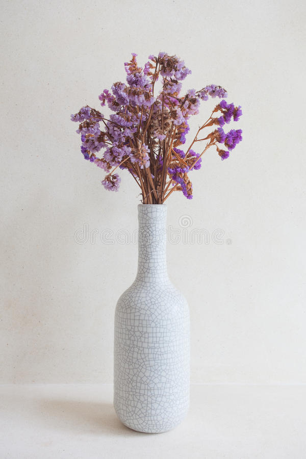 Purple orchid flowers in white vase stock images