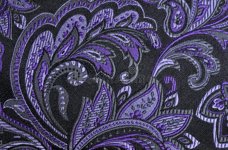 Purple paisley. Print on fabric stock photo