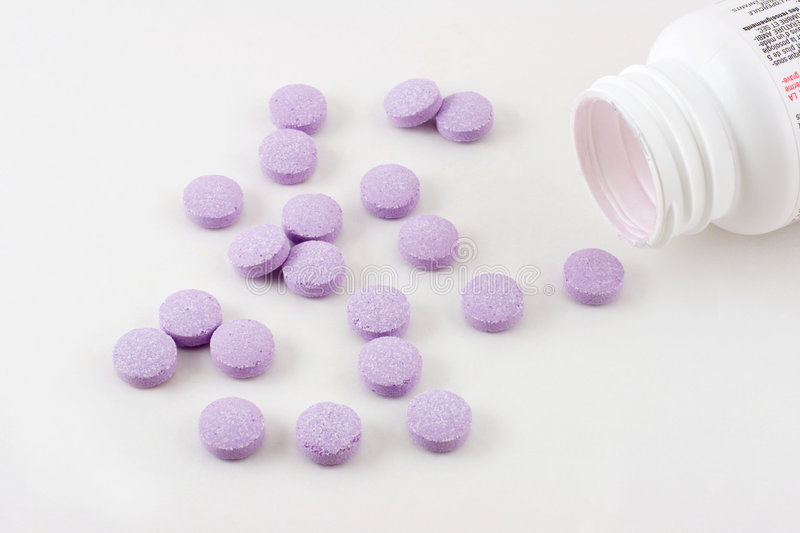 Purple Pills Medicine Bottle Stock Photos