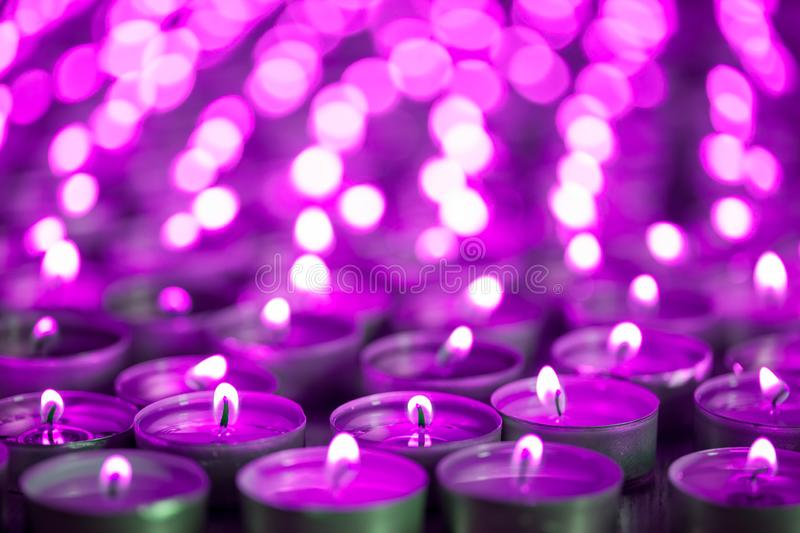 Purple pink candle light. Christmas or Diwali celebration tealight candlelight. Christmas vigil lights. Purple pink candle light. Christmas or Diwali celebration stock photography