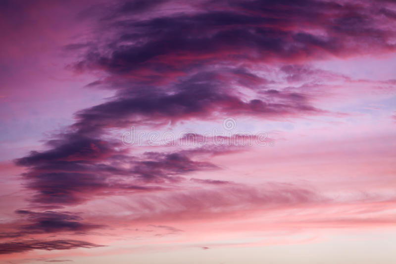 Purple and pink colors in sunset sky. Purple and pink colors in sunset dramatic sky stock photos