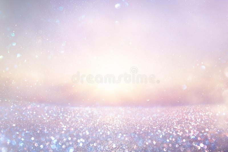purple and pink glitter vintage lights background. defocused. stock images