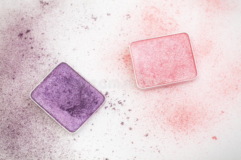 Purple and pink make-up palettes. And crumbs on white stock photo