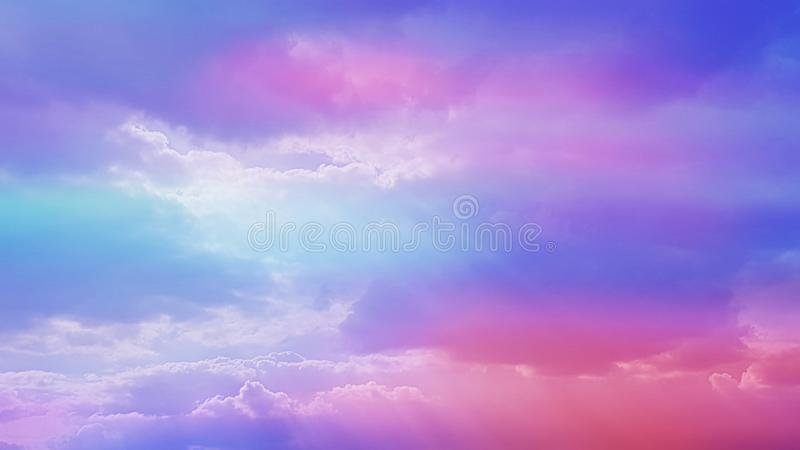 Purple and pink sky with clouds and sunrays stock photos