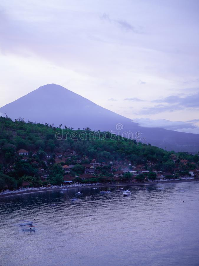Sunset at Jemeluk bay overlooking Mt. Agung in Bali stock images