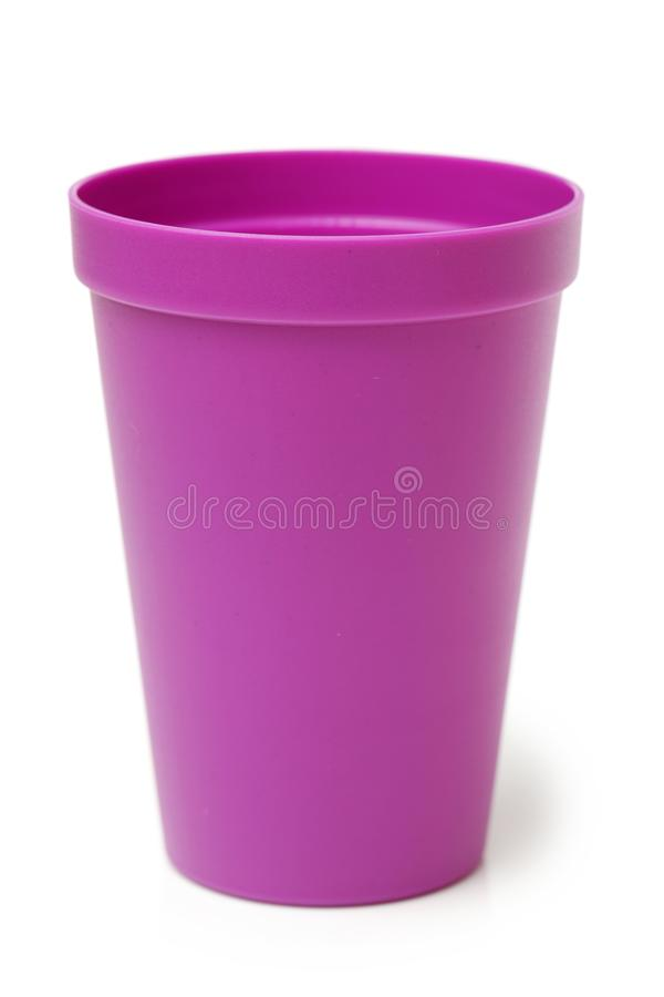 Purple Plastic cup. Isolated on white background stock photography