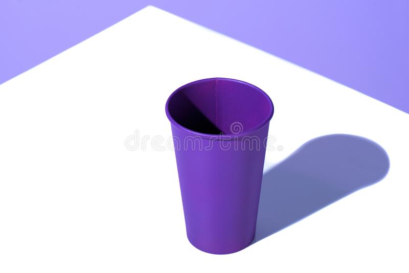 Purple plastic disposable cup,. On white surface stock photography